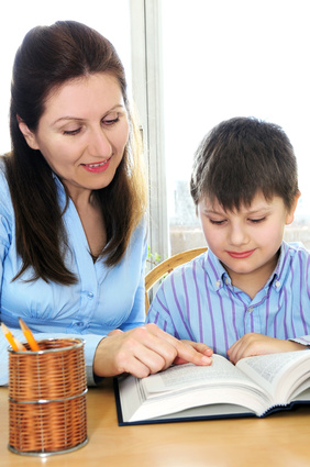 tutor helping young boy to study